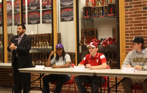 Seniors commit to participate in college athletic programs