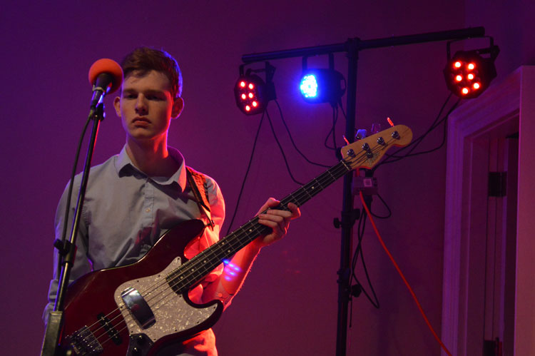 Senior Mitch Huffman looks stoic as he gets ready to serenade the crowd during Can Jam. Can Jam was a fundraising concert held on Jan. 16, led by Tri-Hi-Y, and offered an opportunity for student-led music groups to perform for an audience.