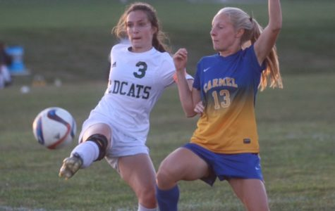 Carmel puts onslaught on Lawrence North with 5-0 conference victory: Photo Gallery