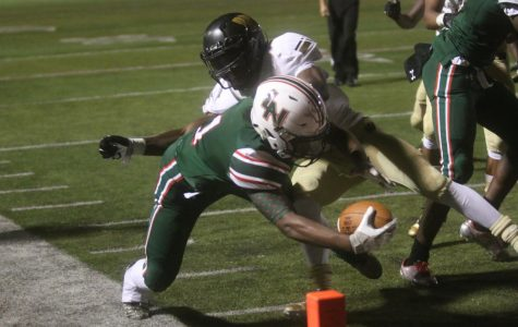 Warren dominates, spoils LN homecoming: Photo Gallery